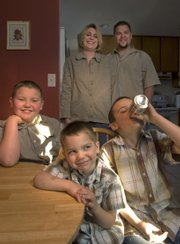Rachel and Phillip Cullison allow their boys Elijah (from left), Isaiah and Micah to drink pop.