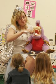 The Tooth Fairy, aka Sally Stillings, demonstrates the proper way to brush your teeth to a group of students at Hilltop Child Development Center at Kansas University. The Douglas County Dental Clinic sends the Tooth Fairy on missions to teach children about tooth care.