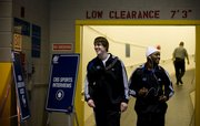Kansas guards Conner Teahan and Sherron Collins have a laugh as they leave the Metrodome following a day of interviews and practice Saturday March 21, 2009.