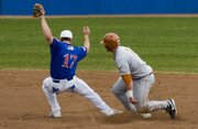 Kansas shortstop David Narodowski beats Texas Longhorn Preston Clark to second base in the top of the seventh inning. KU played host to Texas Sunday at Hoglund Ballpark.