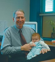 When Tom Mundinger's first grandchild, Mason Thomas Banks, was born just before Christmas, the longtime Baldwin School District principal decided it was time to retire — for good — after 37 years in education. He is the only principal Baldwin Elementary School Intermediate Center has ever known.