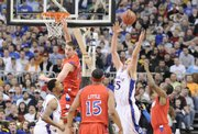 Kansas center Cole Aldrich comes up with a rebound over Dayton during the first half Sunday, March 22, 2009 at the Metrodome in Minneapolis.