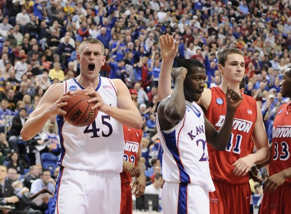 Kansas center Cole Aldrich screams in jubilation after getting a bucket and a foul Dayton during the first half Sunday March 22, 2009 at the Metrodome in Minneapolis. At right is Kansas forward Mario Little, Dayton center Kurt Huelsman and Dayton forward Chris Wright.