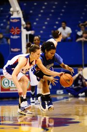 Ivana Catic goes for a loose ball against Creighton's Chevell Herring in the first half.