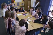 Sixth-grade students at Quail Run School prepare for a mock trial with the help from Kansas University law students in this 2009 file photo. Meetings for parents of sixth-grade students begin this week as enrollment kicks off.