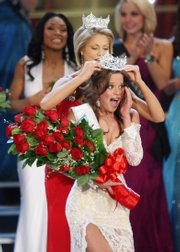 Miss Indiana Katie Stam is crowned Miss America 2009 by Miss America 2008 Kirsten Haglund in Las Vegas on Jan. 24. Haglund has started a foundation to help others overcome eating disorders.