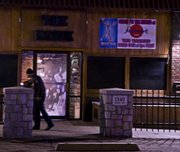 Police Thursday night investigate the outside patio of The Hawk, a popular student bar near the KU campus, after a shooting sent two students to the hospital