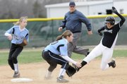 Paige Rothwell, right, slides into second-base for a stolen base in the Free State Firebirds season home opener against Shawnee Mission East Thursday at FSHS.