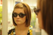 Mallory Zornes, an employee for Wink Eyewear, 806 Mass., models L.A. Eyeworks sunglasses, which start at $200.
