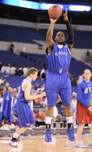 Kansas guard Sherron Collins puts up a jumper during practice Thursday at Lucas Oil Stadium in Indianapolis.
