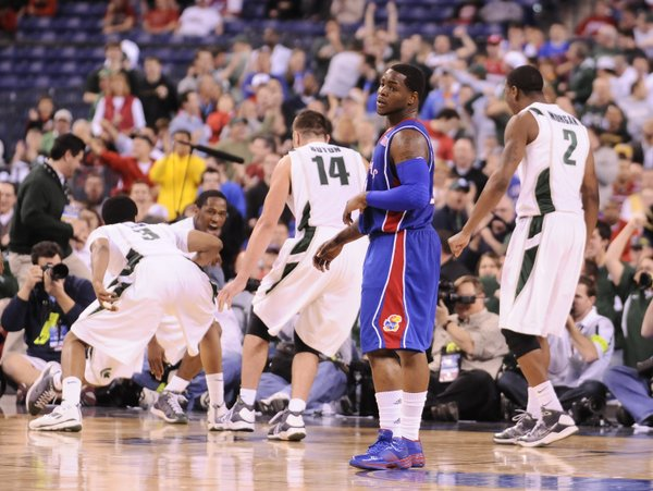 Kansas guard Sherron Collins looks back to the Kansas bench after fouling Michigan State guard Kalen Lucas on a made bucket late in the second half Friday, March 27, 2009 at Lucas Oil Stadium in Indianapolis.