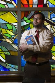 """Michael Zogry, assistant professor of religious studies at Kansas University, presents a lecture, """"Religion and Basketball: Naismith's Game,"""" on Thursday. Zogry recently found a Lucite piece commemorating Phog Allen inside Allen Fieldhouse."""