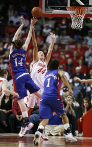 University of New Mexico's Angela Hartill tries to stop a shot by Kansas' Krysten Boogaard during the second half of the fourth round of the WNIT basketball game on Monday, March 30, 2009 in Rio Rancho, N.M. Kansas won 78-69. Also pictured is Aishah Sutherland (1).