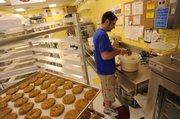 Michael Neth, an owner of Eileen's Colossal Cookies, 4931 W. Sixth St., Suite 124, works on a batch of cookies at the store. The business opened in January.