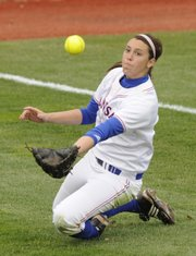 Kansas' Allie Clark slides to catch a fly ball in the third inning against Missouri on Wednesday at Arrocha Ballpark.
