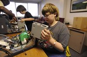 Jesse Jacob, 14, Central Junior High School student, learns Saturday how to take apart a computer as part of a Youth Education Association program at the United Way Building at 2518 Ridge Court. He was one of six children attending.