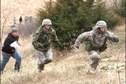From Left, Ssc. Joseph Masarik, Mark Boyle and Jr. Cadet Ryan Fritz run up a hill during the obstacle course portion prepared for the Army ROTC 15th Ranger Buddy competition.