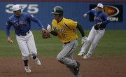 Kansas' Tony Thompson, left, lines up a throw to first base to end a Baylor threat. KU fell to the Bears, 21-9, Sunday at Hoglund Ballpark. Story on page 1B