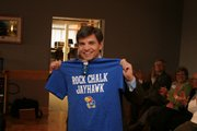 George Stephanopoulos, chief Washington correspondent for ABC News, shows off a Kansas University T-shirt he received as a gift during a visit here earlier this month. Stephanopoulos visited the Lawrence Community Shelter and also spoke at KU. Monte Mace, Lawrence, submitted the picture.