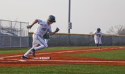 Lawrence Free State outfielder Connor Stremel gets a base hit and sends Michael Lisher to home plate during the fourth inning of Tuesday's baseball game against Olathe Northwest.