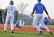 Lawrence Free State outfielder Connor Stremel slides to home plate during the fourth inning in Tuesday's baseball game against Olathe Northwest.