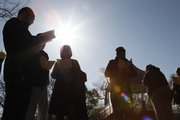 Rabbi Zalman Tiechtel leads a group of worshipers in reciting Birchas Hachama, a rare, once-in-28-years Jewish blessing of the sun, Wednesday morning in South Park under clear skies in brilliant sunshine.
