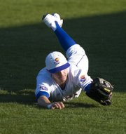 Kansas University Right fielder Brian Heere makes a diving catch in the first inning. The Jayhawks beat Oklahoma State, 8-1, Friday at Hoglund Ballpark.