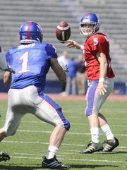 Blue team quarterback Todd Reesing pitches to running back Jake Sharp during the first half of the 2009 Spring Game Saturday, April 11, 2009 at Memorial Stadium.