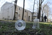 Empty cups from a recent party litter grass and sidewalk on the 1200 block of Ohio Street Saturday morning,