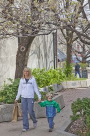Karen Wray strolls and shops along Massachusetts Street with her son Cooper in spite of her allergies, which have been exceptionally bothersome this year. Tree pollen became a problem for some allergy sufferers in February this year.