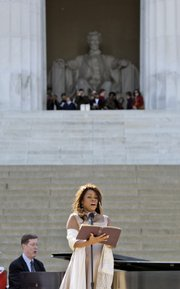 Wearing Marian Anderson's gown, Denyce Graves performs Sunday at the Lincoln Memorial in Washington during a concert to commemorate Anderson's performance at the memorial 70 years ago.
