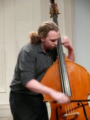 Ozzie Backus V has been without his beloved bass since it was stolen in December in Puerto Vallarta, Mexico. Backus, a graduate of the New England Conservatory of Music, has ordered a new bass which costs $18,000.