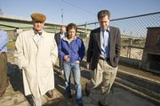 Senator Sam Brownback, right, was in Lawrence on Tuesday getting a first-hand look at renewable energy sources. Stephen Hill, president of Bowersock Mills and Power Co., and Sarah Hill-Nelson showed Brownback the facility.