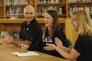 Molly Albrecht, center, is joined by Lawrence Aquahawks coach Mike Soderling, left, and FSHS swimming coach Annette McDonald. Albrecht signed with Yale on Wednesday at FSHS.