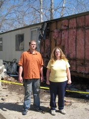 Sarah Klebenstein and her neighbor Donald Haime stand outside Klebenstein's mobile home in Eudora. The home was damaged early Tuesday by a fire, which was largely confined to the exterior of the structure.