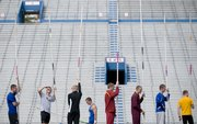 Decathletes bide their time while waiting in line for practice vaults on the second day of the Kansas Relays Thursday, April 16, 2009 at Memorial Stadium.