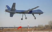 In this photo released March 31 by Homeland Security's Customs and Border Protection Agency is an unmanned aircraft used to monitor Red River flooding as it lands at Grand Forks, N.D., Air Force Base on Feb. 16.