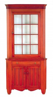 "Red stain and good design add to the value of this two-part 1830s Pennsylvania corner cupboard. It sold recently at a Pook & Pook auction in Downington, Pa., for $15,200. Did you know a ""cup board"" was a shelf for cups and dishes? When many shelves were boxed into a large piece of furniture, it became a ""cupboard."""