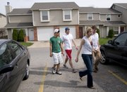 Amber Allen, manager of Sunrise Village 660 Gateway Ct., foreground right, takes a group of KU sophomores on a tour of the townhouse complex  Friday, April 17, 2009. From left are students and prospective renters Chris Lou, Chicago, Matt Johnson, Salina, and Tucker Allred, Salina. With Lawrence full of apartment and townhouse complexes, the rental market is competitive. Many are offering move-in incentives.
