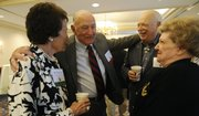 From left, Edith Darby Evans, Don Fambrough, and Don and Pat Orton, all Gold Medal Club members, meet at the Adams Alumni Center, 1266 Oread Ave., to mark 50 years as Kansas University alumni in this 2009 file photo. Nearly 130 people attended the annual reunion.