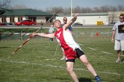 Jeremy Elliot finished first in the javelin on Thursday at the Tonganoxie Invitational with a throw of 142 feet, 8 inches. Elliott's dad, Rex Elliott, is in the background. Jeremy died in his sleep Thursday night from a heart condition.
