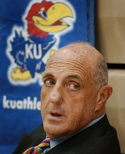 Lew Perkins: Athletics director at Kansas Athletics Inc. He led the charge to sue Larry Sinks over the T-shirt business. He agreed to accept settlement that had Sinks closing his business while not paying damages or legal fees. 