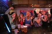 Paige Floodman cheers on the Jayhawks while at Jo Shmo's on March 27.
