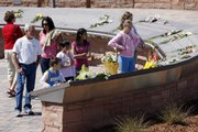 Flowers are placed on the plaques to the 13 victims of the massacre at Columbine High School to mark the 10th anniversary of the killings, at Columbine Memorial in the southwest Denver suburb of Littleton, Colo., on Monday, April 20, 2009.