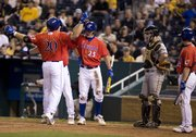 KU's Preston Land (20) celebrates with the teammates after hitting a three-run homer in the sixth inning to give the Jayhawks a 5-3 lead against Missouri Wednesday, April 22, 2009 at Kauffman Stadium.