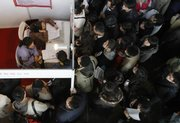 Desperate job seekers wait to submit applications at a job fair in Beijing. The IMF predicted the global economy will shrink 1.3 percent this year, despite efforts to stimulate economies across the globe.