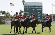 Players on the Audi polo team ride their horses onto the field Thursday during the semifinals of the U.S. Open Polo Championships at the International Polo Club Palm Beach in Wellington, Fla. Twenty-one polo horses from the Venezuelan-owned team Lechuza died Sunday.