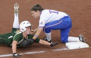 KU third baseman Val Chapple, right, tags out a Baylor runner on a play at third in the bottom of the sixth inning in KU's 7-3 win over Baylor in the first game of a double-header Saturday at KU.