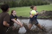 KU student Stephanie Thompson, Lenexa junior, right, digs a shot during a mud volleyball game on Saturday, April 25, 2009, on the west side of the KU campus.  The mud volleyball games were a part of the first annual Hawk Mudfest, sponsored by the KU Endowment.  The registration fees for the volleyball tournament will go to creating a Students for KU Student Leadership Award.
