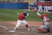 Kansas' Robbie Price gets hit in the head by a pitch from Nebraska's Mike Nesseth during the double-header on Sunday, April 26, 2009, at Hoglund Ballpark.